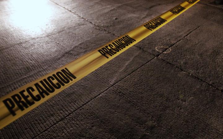 A police tape surrounds a crime scene in Mexico City, Mexico.