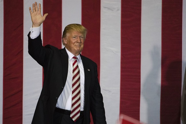 Republican presidential candidate Donald Trump waves during a campaign stop at the Jacksonville Equestrian Center in Jacksonville, Fla, Thursday, Nov. 3, 2016. (AP Photo/Matt Rourke).