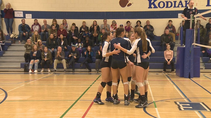 The River East Kodiaks celebrate a point against the Westwood Warriors in a quarterfinal game during the MHSAA AAAA Girls' Volleyball Championship.