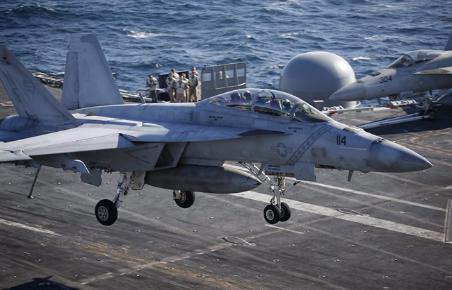 A U.S. Navy F/A-18 Super Hornet fighter lands onto the deck of the USS Ronald Reagan during a joint naval drill between South Korea and the U.S. in the West Sea, South Korea, Oct. 28, 2015.