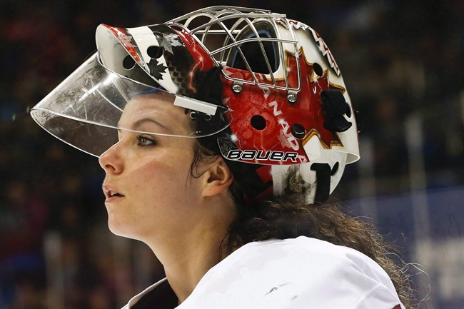 In this Feb. 17, 2014 file photo, goalkeeper Shannon Szabados of Canada skates off the ice after the second period of the 2014 Winter Olympics women's semifinal ice hockey game against Switzerland at Shayba Arena in Sochi, Russia.