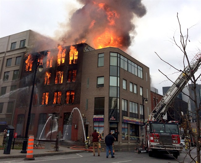 Firefighters battle a blaze in Montreal's Chinatown district at the Robillard building, which once housed Canada's first movie theatre, on Thursday, November 17, 2016.