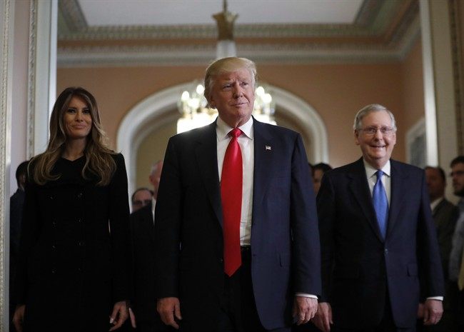 President-elect Donald Trump and his wife Melania walk with Senate Majority Leader Mitch McConnell of Ky. after a meeting on Capitol Hill on Nov. 10, 2016. THE CANADIAN PRESS/AP, Alex Brandon.