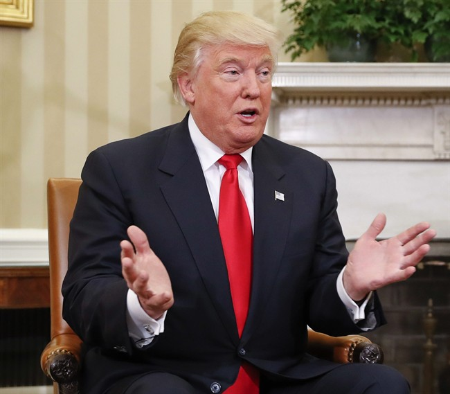 Donald Trump, seen here in the White House, may tweak his tone when confronted with the challenges of governing, Prime Minister Trudeau said Friday.