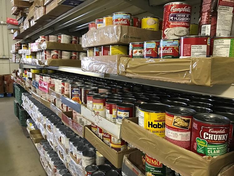 Cans on a shelf inside a Lethbridge food bank.