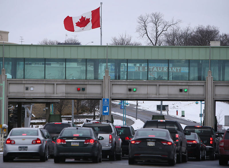 Vehicles make their way through the Canadian border crossing in Niagara Falls, Ontario, in January of 2016.