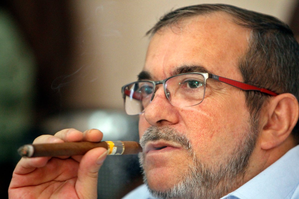 Rodrigo Londono smokes a cigar while waiting for the final count of votes of the plebiscite held in Colombia on October 02, 2016 in Havana, Cuba.