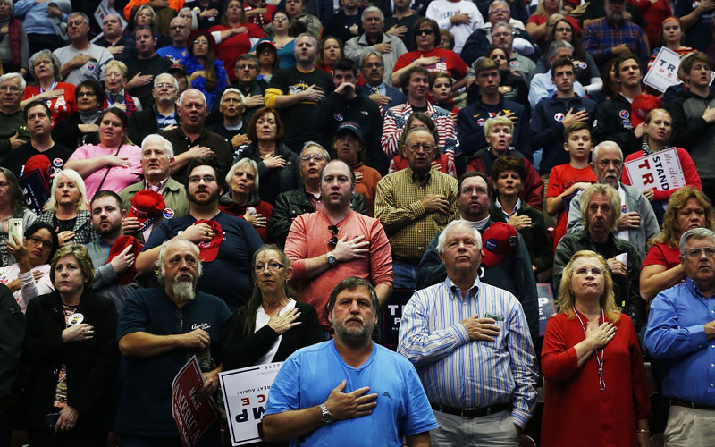 Donald Trump supporters wait for him to speak at a rally on November 4, 2016 in Hershey, Pennsylvania. Days before the presidential election, both Hillary Clinton and Donald Trump make their final pitches to the American people, with recent polls show a tightening race in crucial swing states.