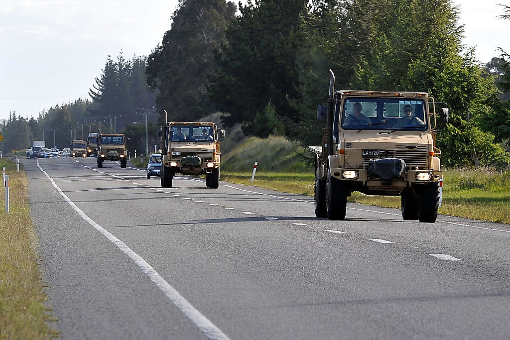 An army convoy brings supplies to the town of Kaikoura after an earthquake on November 14, 2016.