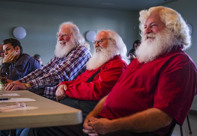 In this file photo Santa Clauses Bob Slocombe, left, Dan Dickison, centre, and Jeff Badyk listen to instructors at Santa School in Calgary, Alta., Friday, Oct. 21, 2016.