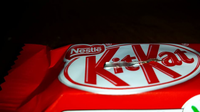 A sharp metal object is seen stuck inside this Kit Kat bar, found in a Halifax boy's bag of candy.
