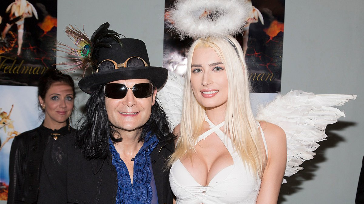 """Corey Feldman (L) and Courtney Anne Mitchell aka DJ AC attend Feldman's Album Release Party For """"Angelic 2 The Core"""" at Adults Only on June 29, 2016 in Los Angeles, California."""