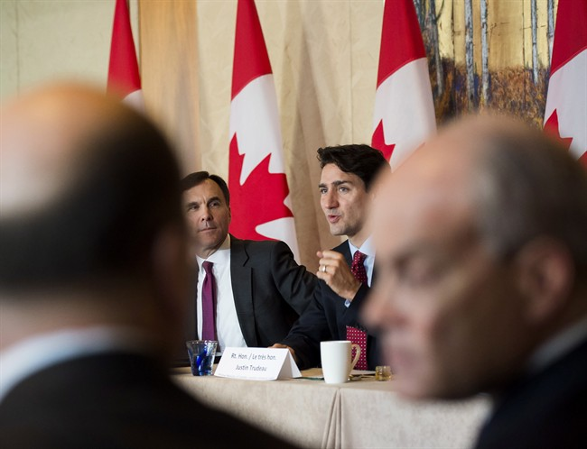 Prime Minister Justin Trudeau, back right, and Finance Minister Bill Morneau, back left, participate in a infrastructure round table in Toronto, Nov. 14, 2016.