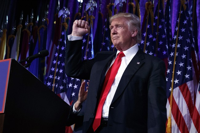 President-elect Donald Trump pumps his fist during an election night rally, Wednesday, Nov. 9, 2016, in New York.