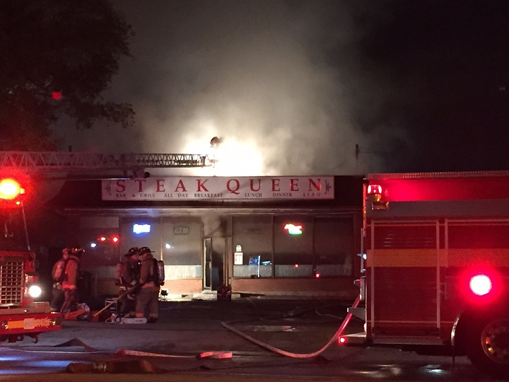 Firefighters at the scene of a fire at the Steak Queen restaurant in Etobicoke on Nov. 8, 2016.