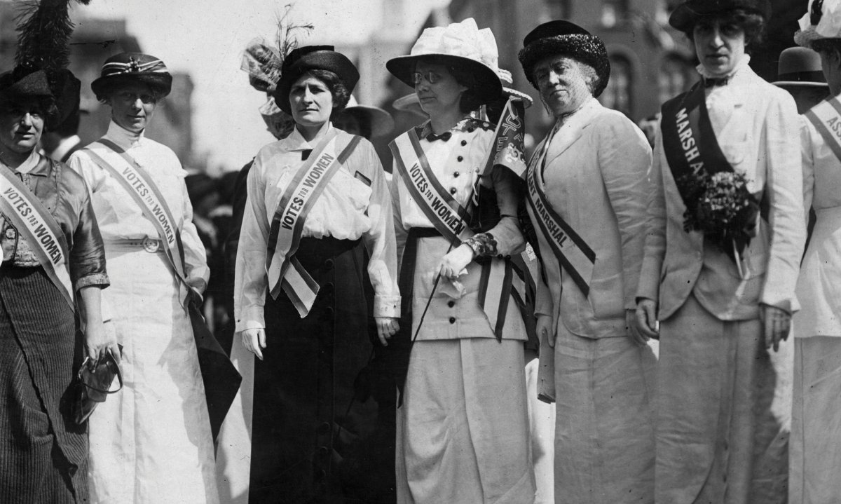 Inez Haynes Gillmore, Hildegarde Hawthorne, Edith Ellis Furness, Rose Young, Katherine Licily and Sally Splint represent female authors, dramatists and editors during a New York women's suffrage parade.
