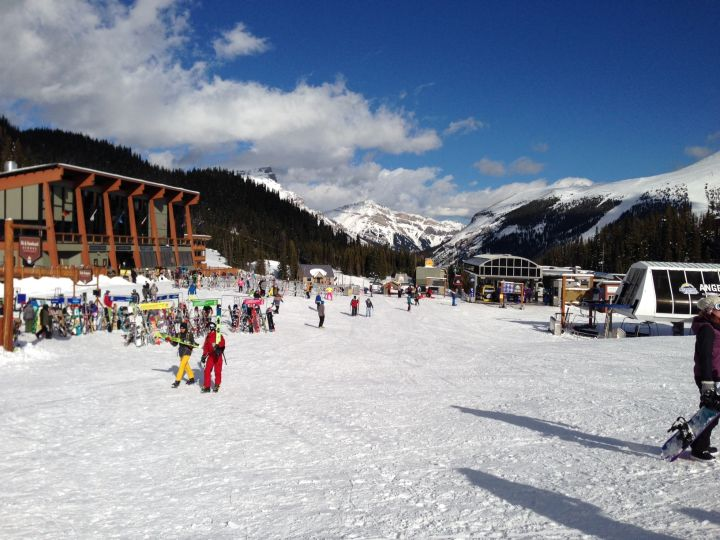 Skiers and snowboarders enjoy a sunny day at Sunshine Village.