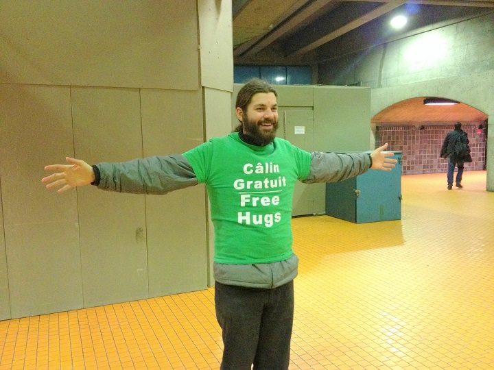 In this November 2016 photo, Tommy Boucher stands in the Montreal Metro to give free hugs.
