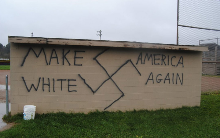 "In New York State, the words ""Make America White Again"" was spray painted on a dugout at a baseball field in Wellsville. A large swastika was also painted on the dugout."