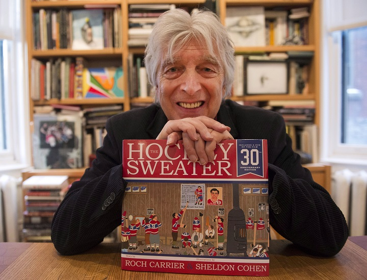 "Roch Carrier, author of the book ""The Hockey Sweater,"" poses for photos Wednesday, November 19, 2014 in Montreal."