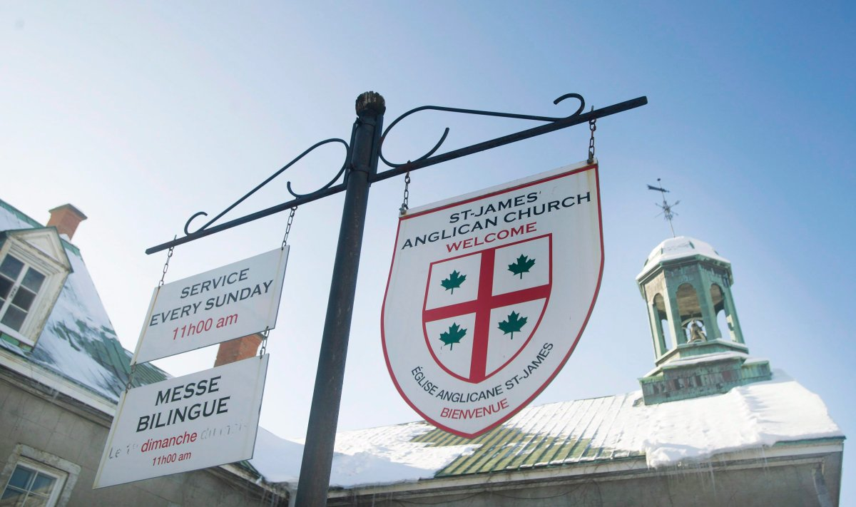 Signs in English and French hang outside St. James Anglican Church in Trois-Rivières, Que., Sunday, January 25, 2015.   The Nova Scotia and Quebec governments have signed an agreement aimed at preserving Canada's French-speaking communities.