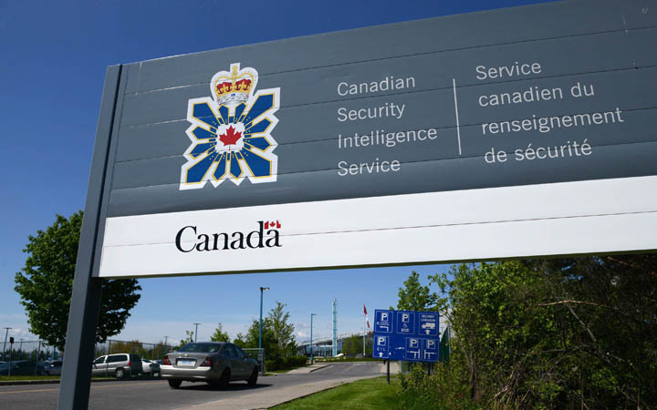A sign for the Canadian Security Intelligence Service building is shown in Ottawa on May 14, 2013. Canada's spy agency is openly warning that Russia and China are out to steal the country's most prized secrets.