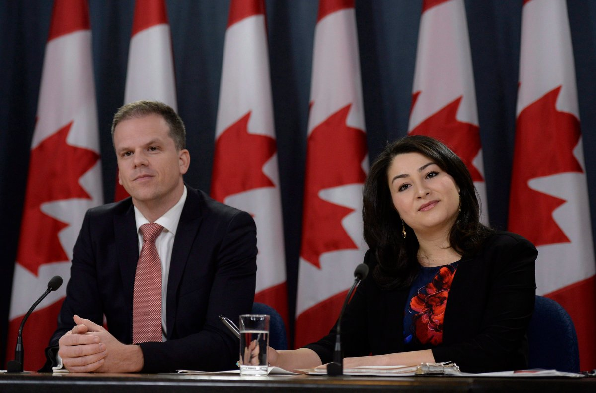 Minister of Democratic Institutions Maryam Monsef (right) and Parliamentary Secretary to the Minister of Democratic Institutions Mark Holland listen to a question during a press conference, on Thursday, Nov. 24, 2016 in Ottawa.