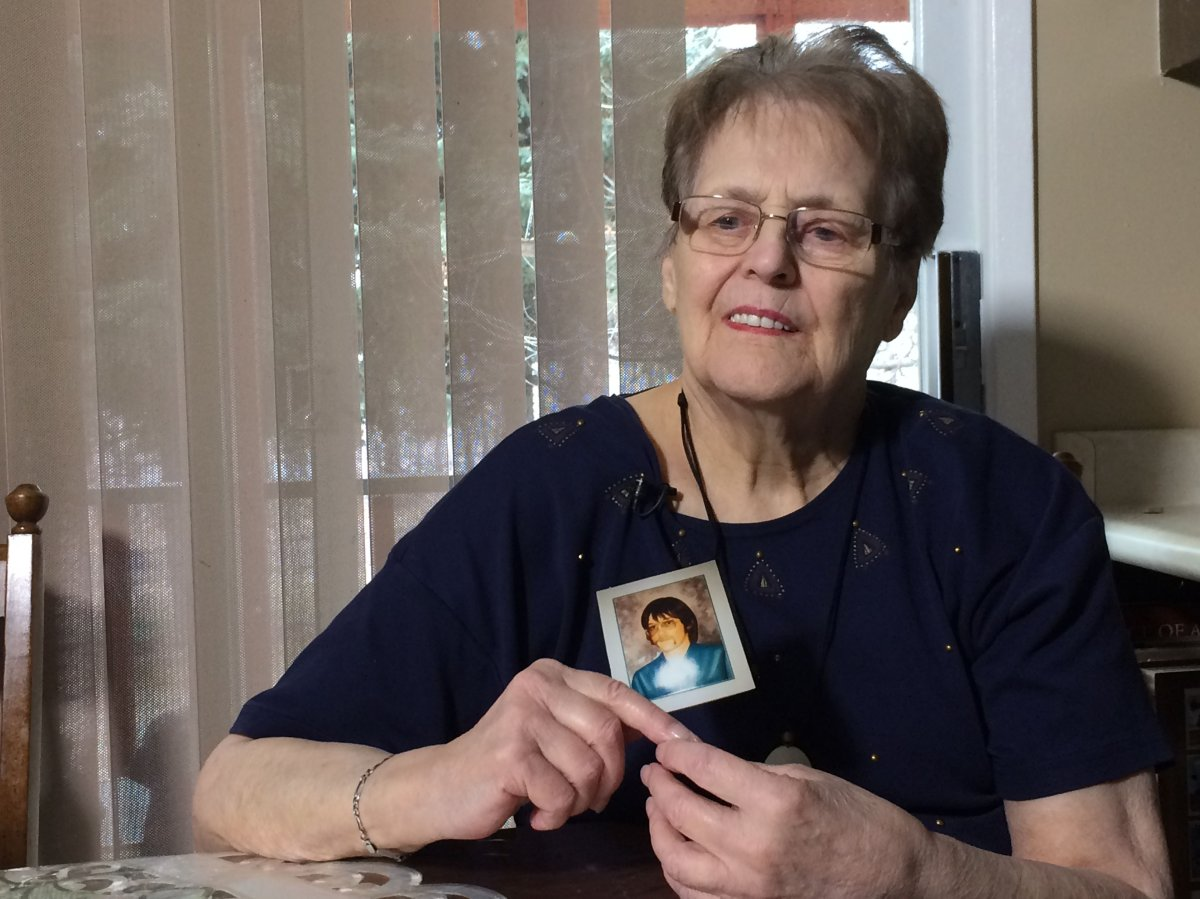 Agatha Syniak holds a picture of her son Dennis, taken on his 18th birthday.