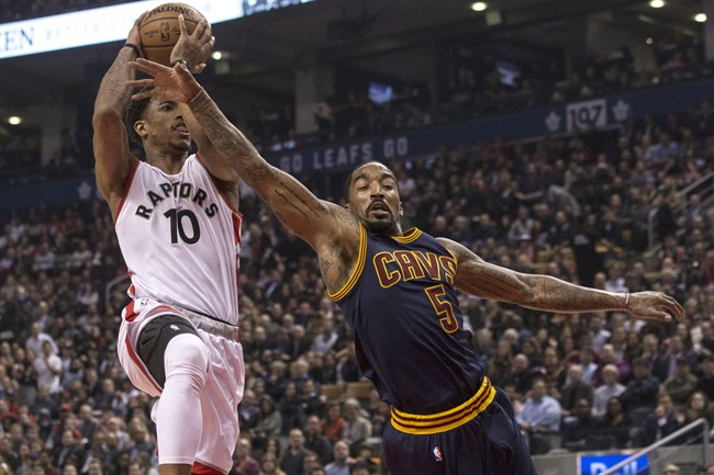 Cleveland Cavaliers guard J.R. Smith (right) tries to stop Toronto Raptors guard DeMar DeRozan drives to the basket during first half NBA basketball action in Toronto on Monday December 5, 2016. THE CANADIAN PRESS/Chris Young.