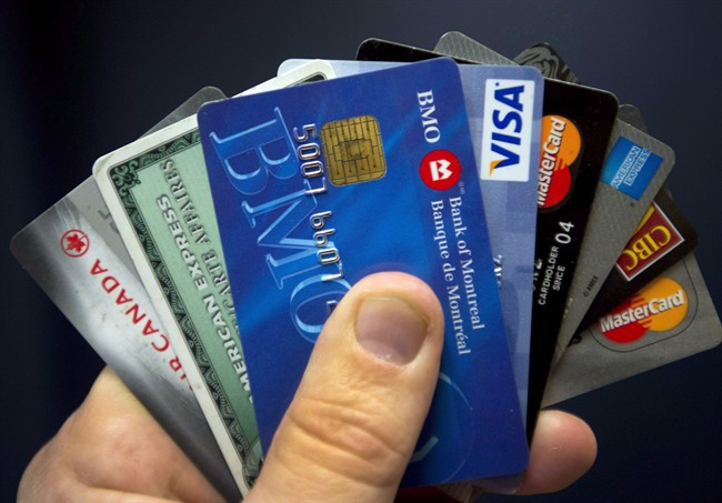 Credit cards are displayed in Montreal, Wednesday, December 12, 2012. The Canadian household debt compared with income climbed to a record high in the third quarter as borrowing grew faster than incomes.