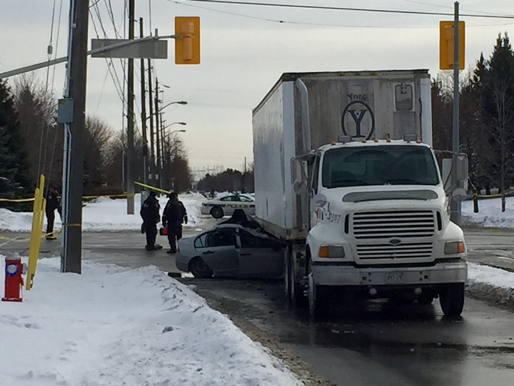 A woman is dead after a collision between a transport truck and a car in Brampton on Dec. 16, 2016.