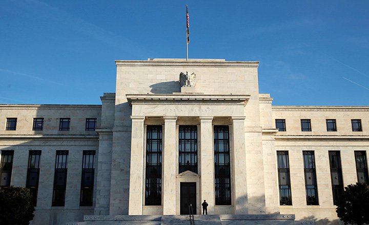 A police officer keeps watch in front of the U.S. Federal Reserve in Washington October 12, 2016.