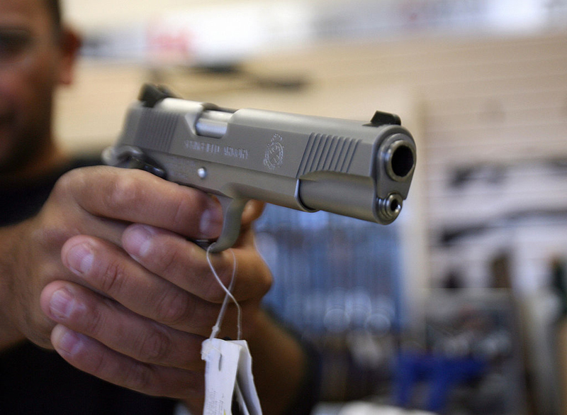 A man handles a handgun for sale in this file image.