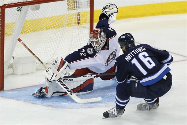 Columbus Blue Jackets goaltender Sergei Bobrovsky saves the shot from Winnipeg Jets' Shawn Matthias during the third period of a NHL game in Winnipeg on Dec. 29, 2016.
