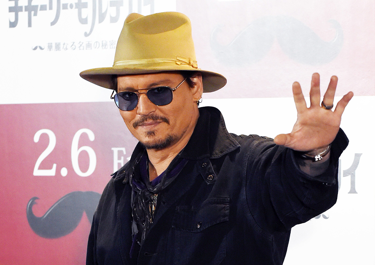 Johnny Depp waves during his photo call in Tokyo on January 28 2015.