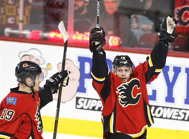 Calgary Flames' Matt Stajan, right, celebrates his goal with Matthew Tkachuk against the Anaheim Ducks during second period NHL action in Calgary, Alta., Sunday, Dec. 4, 2016.