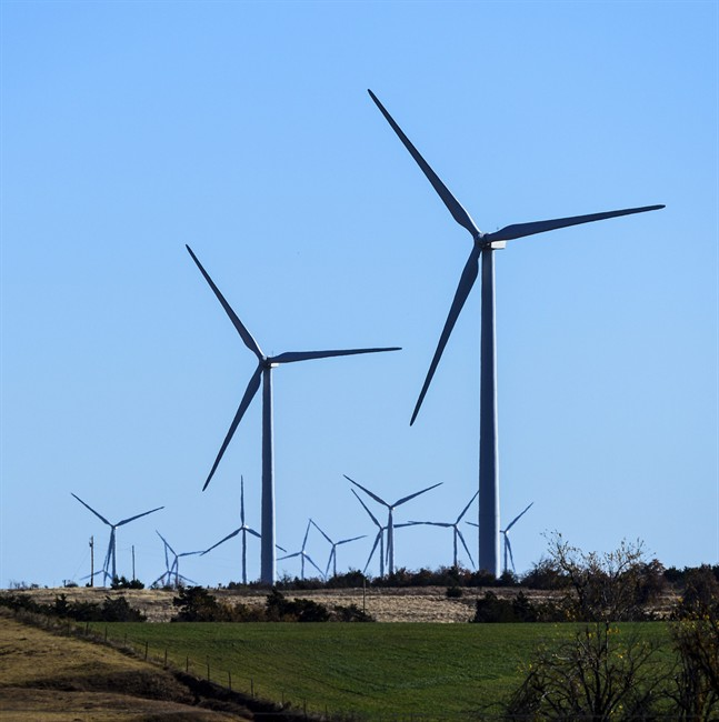 This photo provided by Google shows windmills at a wind farm in Minco, Okla., that provides Google with some of its renewable energy.