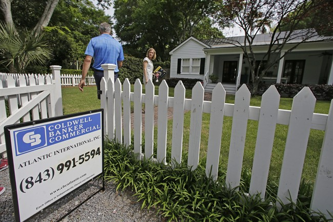 Real estate agent Lauren Newman, right, prepares to show Steve Martin a home for sale in Mount Pleasant, S.C., just over the bridge from historic Charleston.