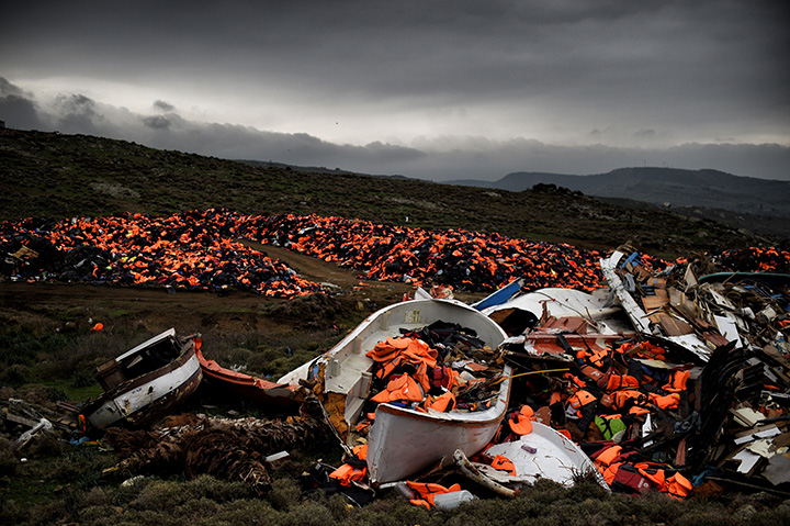 Wrecked boats and thousands of lifejackets, used by refugees and migrants during their journey across the Aegean Sea, lie in a dump in Mithimna, Greece on February 19, 2016.