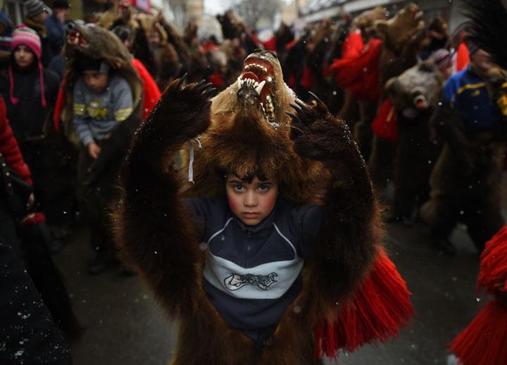 A child wearing a bear skin