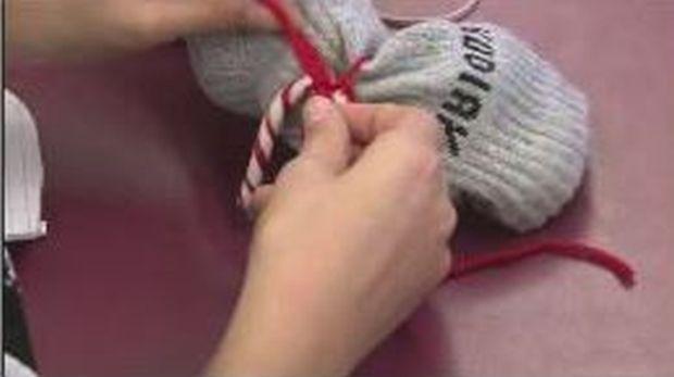 Students at Sunalta School stuff socks to help homeless people in Calgary.