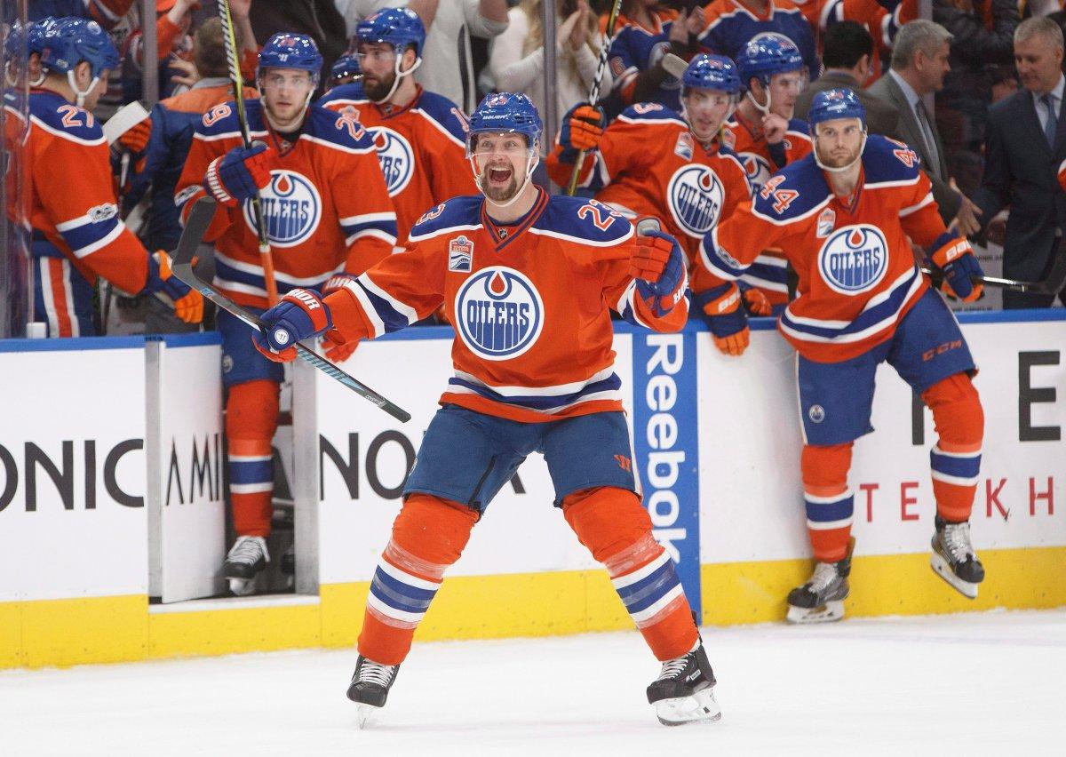 Edmonton Oilers' Matt Hendricks (23) and teammates celebrate the shootout win over the Calgary Flames during NHL action in Edmonton, Alta., on Saturday January 14, 2017.