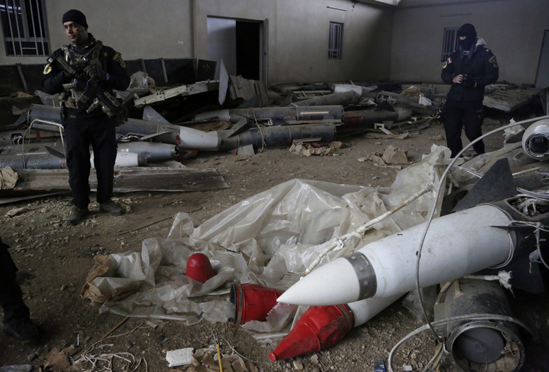 Iraq's special forces troops inspect missiles found in a warehouse in the eastern side of Mosul, Iraq, Jan. 28, 2017.