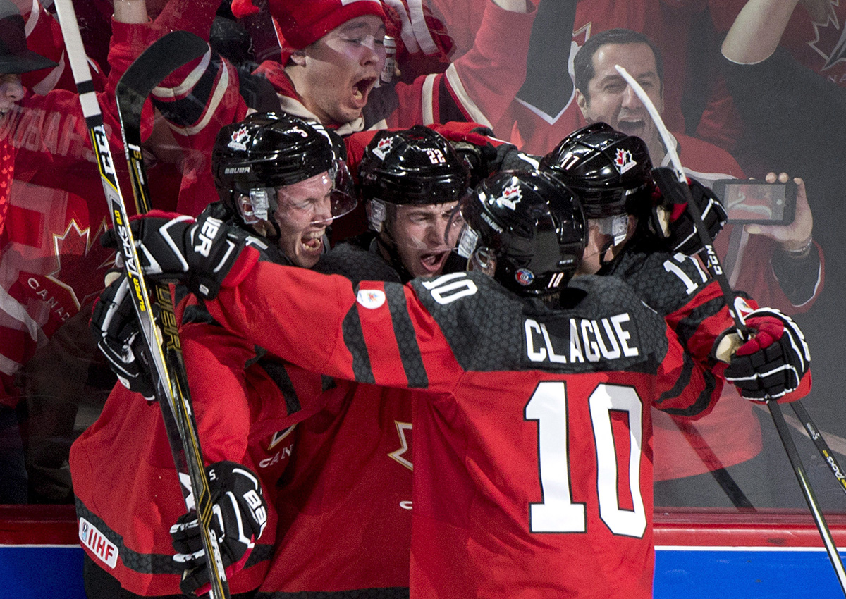 Canada's Anthony Cirelli celebrates his goal against Sweden with teammates during first period IIHF World Junior Championship semifinals hockey action Wednesday, January 4, 2017 in Montreal.