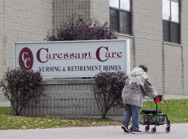A woman walks into the Caressant Care facility in Woodstock, Ont., on Tuesday, Oct. 25, 2016.
