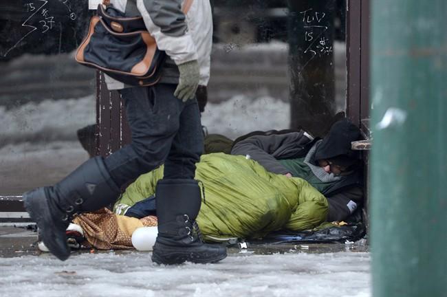 A homeless man sleeps in a doorway in Vancouver's Downtown Eastside, Dec.19, 2016.