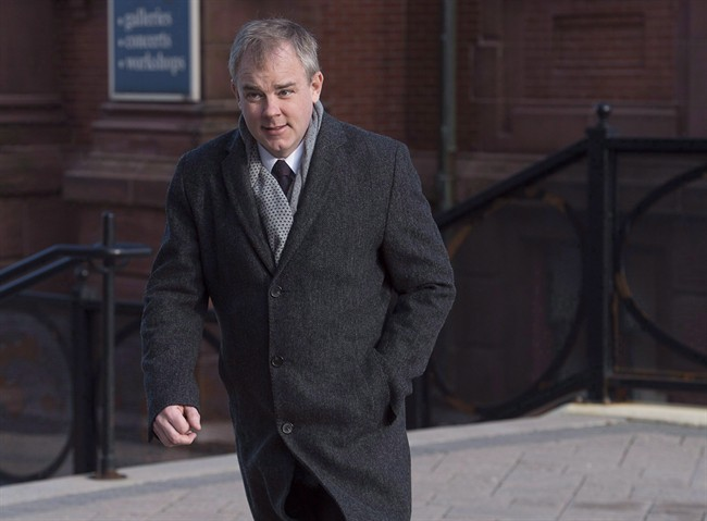 Dennis Oland arrives at Court of Queen's Bench in Saint John, N.B. on Tuesday, Jan. 3, 2017. Two men have been charged with assaulting Oland while he was imprisoned in a federal penitentiary in New Brunswick.