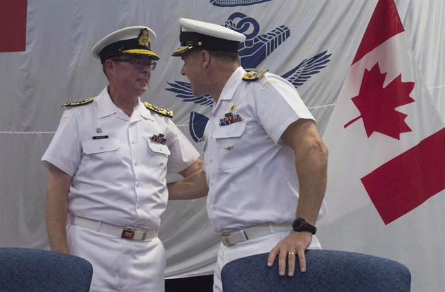 Royal Canadian Navy Vice-Admiral Mark Norman (left) speaks with Vice-Admiral Ron Lloyd during a change of command ceremony, Thursday, June 23, 2016 in Ottawa.