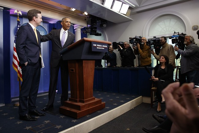 President Barack Obama stands with White House press secretary Josh Earnest during his last press briefing, Tuesday, Jan. 17, 2017, in the briefing room of the White House in Washington. (AP Photo/Evan Vucci).
