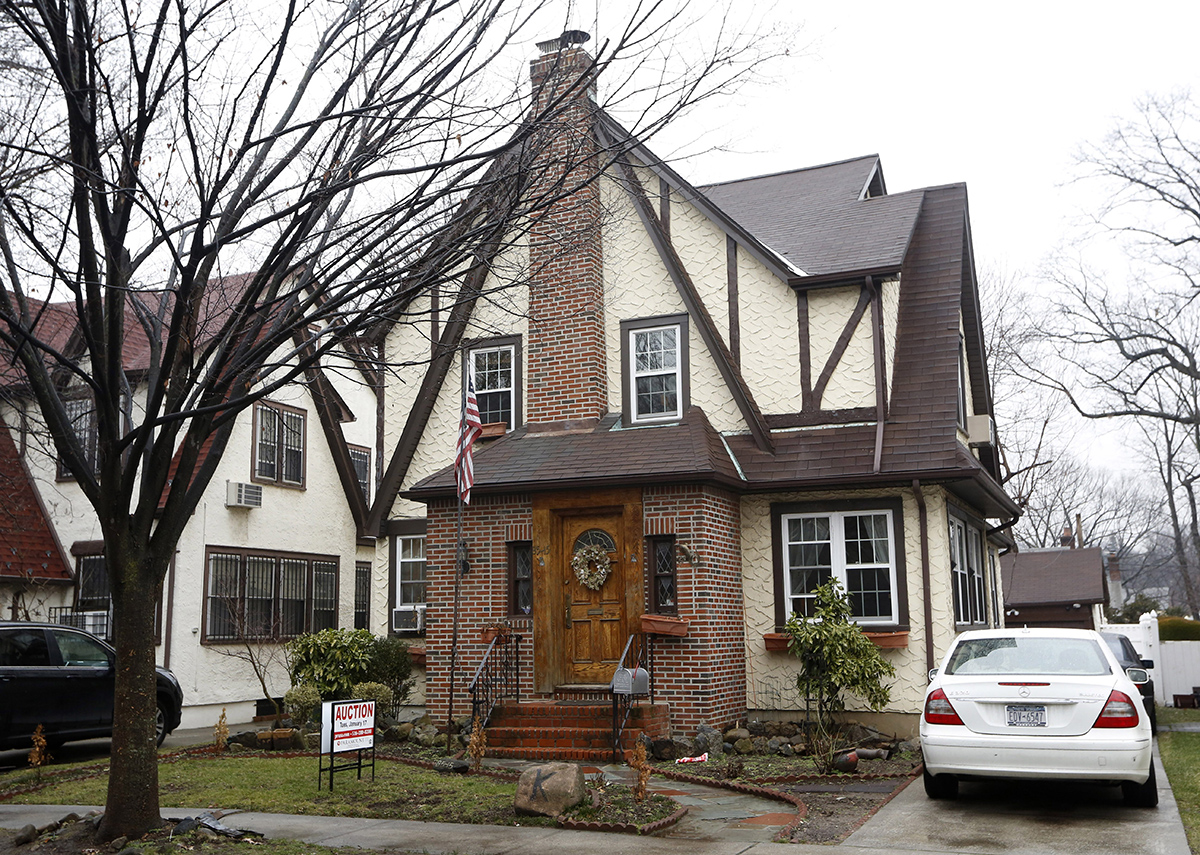 The boyhood home of President-elect Donald Trump, which is going back on the auction block, is shown, Tuesday, Jan. 17, 2017, in New York.
